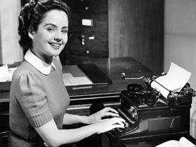 Retro fifties woman typing